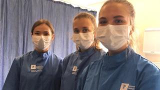 Students back at uni – but with masks and no bars