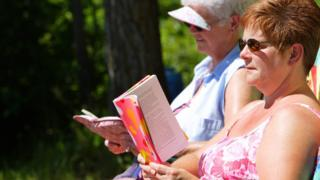 Women relaxing and reading a book