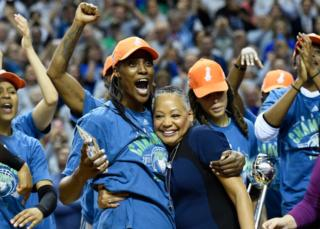 Lisa Borders, President of the WNBA presents Sylvia Fowles of the Minnesota Lynx the MVP of the WNBA Finals after a game against the Los Angeles Sparks in Game Five of the WNBA Finals on 4 October 2017 at Williams in Minneapolis, Minnesota.