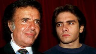 Argentine President Carlos Menem (L) with his son Carlos Facundo (1993 file photo)