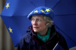 Maggie Moss stands with EU branded dress.