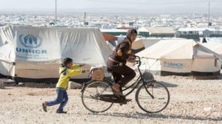 Young Syrian refugees play in the Zaatari Refugee Camp, in Jordan