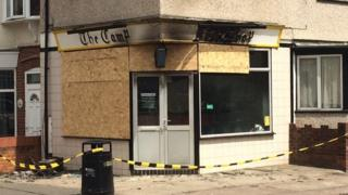 The chip shop as it appears now, with boarded up windows