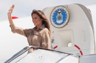 Melania Trump waves as she lands in Malawi