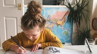 environment Girl writing at a table