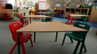 A classroom ready in England for when pupils start returning on Monday
