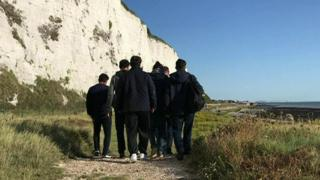 Migrants onshore after they arrived in a dinghy at Kingsdown, Kent