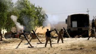 Iraqi soldiers battle Islamic State militants in Ayadiya, north-west of Tal Afar, Iraq (28 August 2017)
