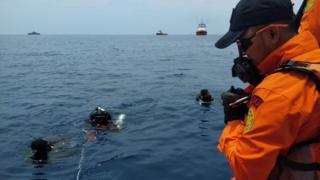 Divers at the crash site off Jakarta, Indonesia