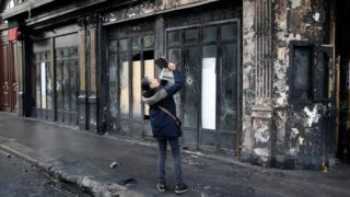 A person takes a picture outside a vandalised restaurant the morning after Paris riots over fuel taxes, December 2, 2018