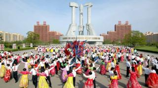 North Korean people dance during an event to mark the 85th anniversary of the country's army