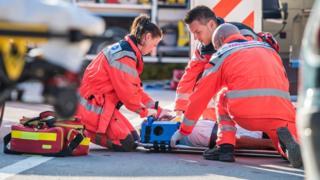 Paramedics treating a patient