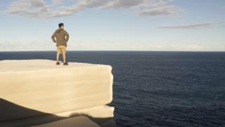 A man standing on Wedding Cake Rock