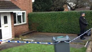 Police officer outside the house in Llanrumney