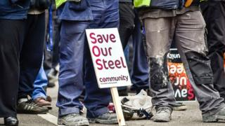 Community members protest outside the Port Talbot steelworks