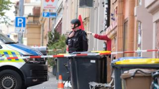 Policemen secure the area around the site of a shooting in Halle