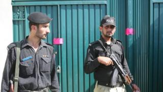 Pakistani police officers stand guard outside the compound where Osama bin Laden was hiding, is on the outskirts of the town of Abbottabad