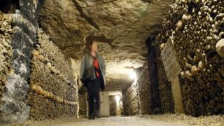 A woman visits the Catacombs of Paris on 14 October 2014