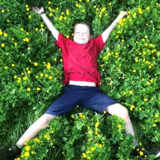 Boy in buttercups