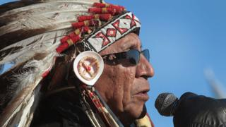 Chief Arvol Looking Horse of the Lakota/Dakota/Nakota Nation speaks during an interfaith ceremony at Oceti Sakowin Camp on the edge of the Standing Rock Sioux Reservation.