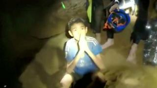 Boys from the under-16 soccer team trapped inside Tham Luang cave greet members of the Thai rescue team in Chiang Rai