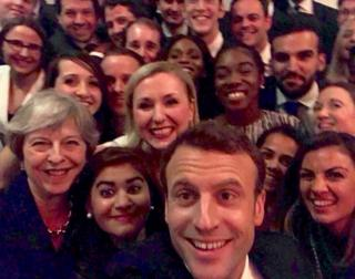 Theresa May and Emmanuel Macron pose for selfie