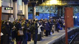Passengers at Glasgow Queen Street station