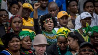 A woman raises her fist during the funeral for Winnie Mandela held at the Orland Stadium on April 14, 2018, in Soweto, South Africa. The former wife of the late South African President Nelson Mandela, anti-apartheid campaigner Winnie Mandela, passed away on April 2, 2018 in Johannesburg, South Africa.