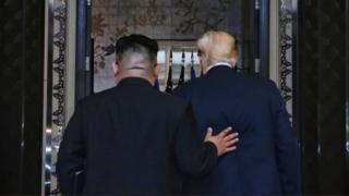 In this handout photograph provided by The Straits Times, North Korean leader Kim Jong-un (L) with U.S. President Donald Trump (R) during their historic U.S.-DPRK summit at the Capella Hotel on Sentosa island