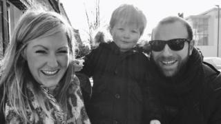 Andy Chambers with his wife and son