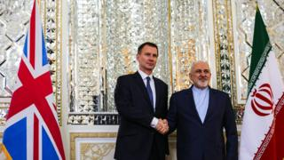 "Britain's Foreign Secretary Jeremy Hunt shakes hands with Iran""s Foreign Minister Mohammad Javad Zarif in Tehran"
