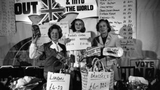 Rachel Hinton, 7, aiding her great aunt Barbara Castle (left), Social Services Secretary, one of Labour's anti-marketeers, and Joan Marten, wife of Neil Marten, Conservative MP for Banbury, at a London press conference in 1975, when Mrs Castle reported on her shopping visit to Brussels to compare prices there to those in London.