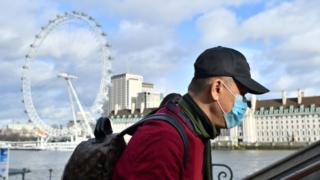 Man in London wearing a face mask