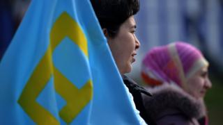 File pic: A Crimean Tatar protests against Russia's move to annex Crimea in Simferopol in 2014