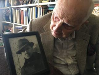 Daniel Cordier with a picture of Jean Moulin