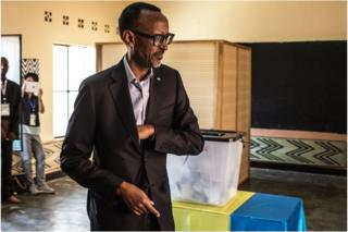 Rwandan President Paul Kagame arrives to cast his vote at a polling station in Kigali, 4 August