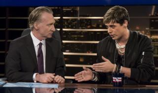 "Bill Maher, left, listens to Milo Yiannopoulos, a writer for Breitbart News, on HBO""s ""Real Time with Bill Maher"" on 17 February 2017"