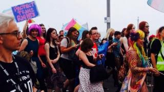 Trans Pride marchers make their way through the streets of Brighton