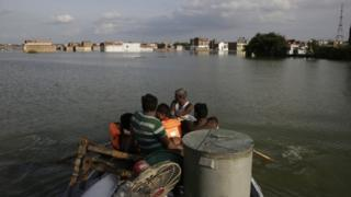 Rescuers shift residents to safer places following floods in the River Ganges in Allahabad, India, Sunday, Aug. 21, 2016.