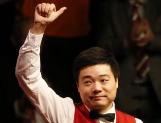 Ding Junhui celebrates winning the semi final match against Alan McManus (not in picture) during day fifteen of the Betfred Snooker World Championships at the Crucible Theatre, Sheffield on 30 April 2016.