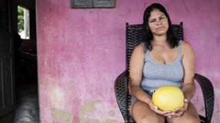 Carmen Priscilla Souza in front of her house in Rio Grande do Norte