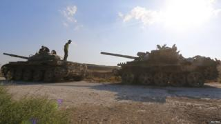 Abandoned army tanks in the village of al-Ziyara, on the Sahl al-Ghab plain, after its fall to Syrian rebels (10 August 2015)