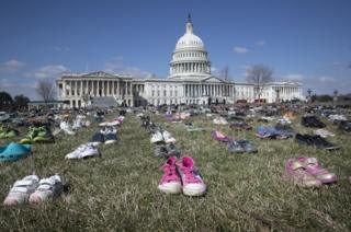 Approximately seven thousand pairs of shoes representing lost children to guns.