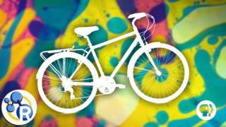 Bicicleta sobre un fondo de colores