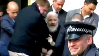 Julian Assange being arrested