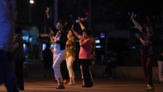 Chinese women dancing in a public space