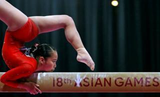 Soyoka Hanawa of Japan in action on the balance beam.