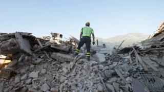 A rescuer in Amatrice on 27 August, 2016