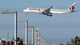 Qatar Airways aircraft over Doha