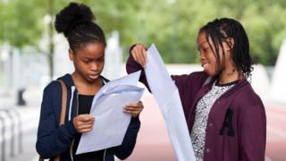 Girls open results envelopes